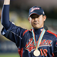 23 March 2009: #18 Daisuke Matsuzaka of Japan is named World Baseball Classic Most Valuable Player as he poses with  the trophy during the 2009 World Baseball Classic final game at Dodger Stadium in Los Angeles, California, USA. Japan defeated Korea 5-3