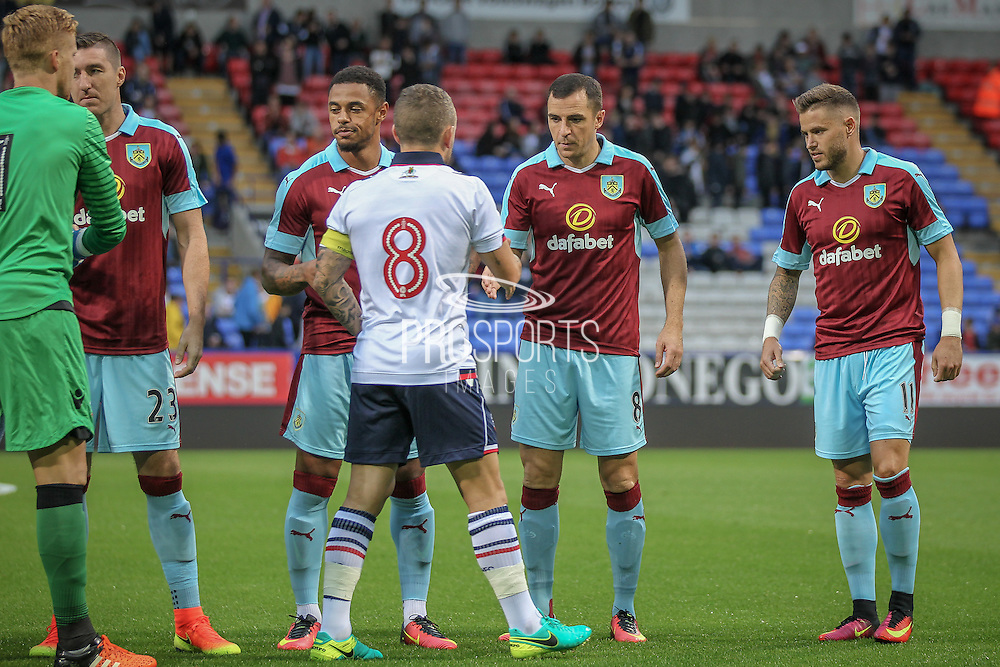 Jay Spearing DM (c) (Bolton Wanderers) shakes the hand of Dean Marney (Burnley) before the Pre-Season Friendly match between Bolton Wanderers and Burnley at the Macron Stadium, Bolton, England on 26 July 2016. Photo by Mark P Doherty.
