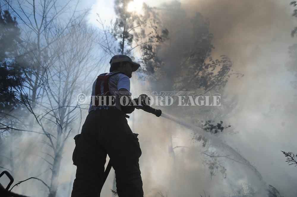 Lafayette County fireman Nate Roy fights a fire on County Road 121 near Abbeville, Miss. on Wednesday, September 29, 2010.