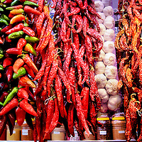 Colorful Chili Peppers and Garlic at La Boqueria Market in Barcelona, Spain<br />