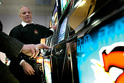 UK ENGLAND LANCASHIRE BLACKPOOL 1DEC04 - An unidentified gambler plays a One-Armed Bandit slot machine at Blackwood College as machine technician Chris ? advises on the best strategy. As part of proactive preparation for the hoped-for arrival of the 'Super-Casinos', Blackpool College has initiated slot machine technician courses to fill the anticipated future gap in the local labour market.....jre/Photo by Jiri Rezac....© Jiri Rezac 2004....Contact: +44 (0) 7050 110 417..Mobile:  +44 (0) 7801 337 683..Office:  +44 (0) 20 8968 9635....Email:   jiri@jirirezac.com..Web:    www.jirirezac.com....© All images Jiri Rezac 2004 - All rights reserved.