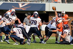 Virginia NT Nick Jenkins (96) blocks a field goal attempt by Richmond kicker Andrew Howard (10).  The block helped preserve a shutout as the Virginia Cavaliers defeated the #3 ranked (NCAA Division 1 Football Championship Subdivision) Richmond Spiders 16-0 in a NCAA football game held at Scott Stadium on the Grounds of the University of Virginia in Charlottesville, VA on September 6, 2008.