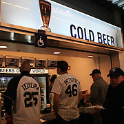 Fans queue for beer inside Yankee Stadium during the New York Yankees V Detroit Tigers Baseball game at Yankee Stadium, The Bronx, New York. 28th April 2012. Photo Tim Clayton