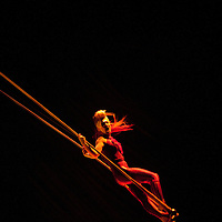 London, UK - 4 January 2012: Acrobat performs at the trapeze during the Cirque Du Soleil Kooza dress rehearsal at the Royal Albert Hall. Since its premiere in April of ..2007, KOOZA has captivated close to four million spectators in North America and Japan.  London will be the first destination of the KOOZA European tour starting the ..5th of January. Written and directed by David Shiner, KOOZA is a return to the origins of Cirque du Soleil combining two circus traditions - acrobatic performance and ..the art of clowning.  KOOZA highlights the physical demands of human performance in all its splendor and fragility, presented in a colorful m&eacute;lange that emphasizes ..bold slapstick humor. This image can be quickly and easily purchased from some of the major international stock agencies:<br /> <br /> Alamy Images, following this link:<br /> http://tinyurl.com/avb24d4<br /> <br /> Demotix, following this link: <br /> http://tinyurl.com/a3mscez<br /> <br /> Barcroft, following this link:<br /> http://tinyurl.com/a6tkquz