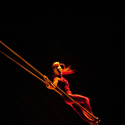 London, UK - 4 January 2012: Acrobat performs at the trapeze during the Cirque Du Soleil Kooza dress rehearsal at the Royal Albert Hall. Since its premiere in April of ..2007, KOOZA has captivated close to four million spectators in North America and Japan.  London will be the first destination of the KOOZA European tour starting the ..5th of January. Written and directed by David Shiner, KOOZA is a return to the origins of Cirque du Soleil combining two circus traditions - acrobatic performance and ..the art of clowning.  KOOZA highlights the physical demands of human performance in all its splendor and fragility, presented in a colorful m&eacute;lange that emphasizes ..bold slapstick humor. This image can be quickly and easily purchased from some of the major international stock agencies:<br />