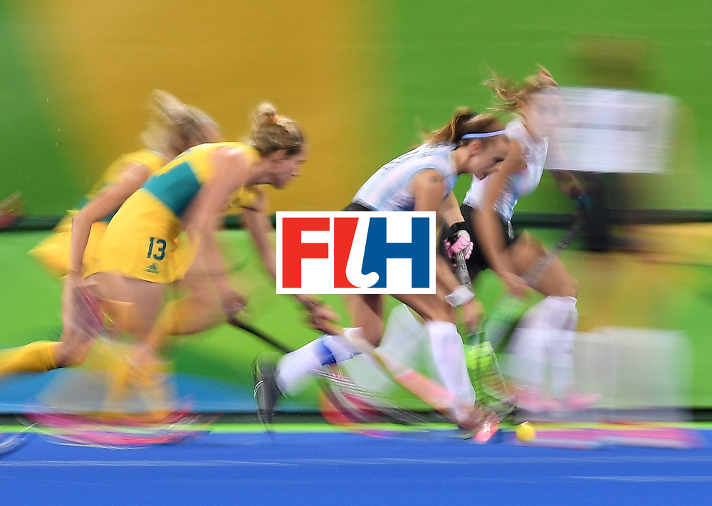 Australia's Edwina Bone (L) chases Argentina's Carla Rebecchi during the women's field hockey Australia vs Argentina match of the Rio 2016 Olympics Games at the Olympic Hockey Centre in Rio de Janeiro on August, 11 2016. / AFP / MANAN VATSYAYANA        (Photo credit should read MANAN VATSYAYANA/AFP/Getty Images)