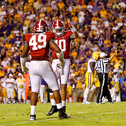 November 3, 2012; Baton Rouge, LA, USA; Alabama Crimson Tide quarterback AJ McCarron (10) celebrates  with defensive lineman Ed Stinson (49) after throwing a game winning touchdown pass to running back T.J. Yeldon (4) against the LSU Tigers during the fourth quarter of a game at Tiger Stadium. Alabama defeated LSU 21-17. Mandatory Credit: Derick E. Hingle-US PRESSWIRE