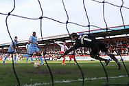 Jimmy Smith of Stevenage (centre) scores his first goal of the game to make it 1-0 during the Sky Bet League 1 match at the Lamex Stadium, Stevenage<br /> Picture by David Horn/Focus Images Ltd +44 7545 970036<br /> 08/03/2014