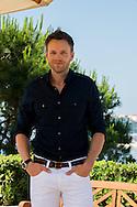 Joel McHale attends 'Community' photocall at the Monte Carlo Beach Hotel on June 9, 2014 in Monte-Carlo, Monaco.o.