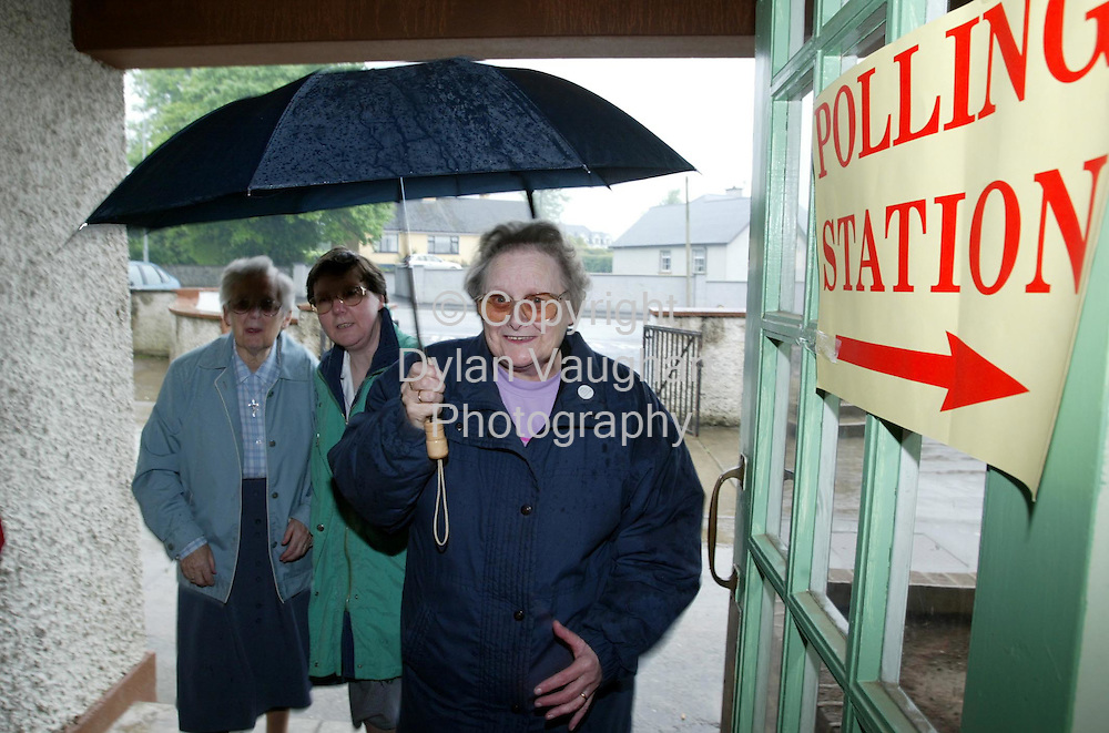 17/5/2002.Voters pictured arriving in out of the rain at the polling station at the boys national school in Thomastown County Kilkenny..Picture Dylan Vaughan