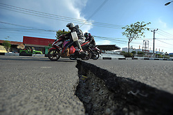 October 2, 2018 - Central Sulawesi, Palu, Indonesia - Cracked roads were crossed by residents from the recent earthquake and tsunami, near Talise Beach in Palu, Central Sulawesi, Indonesia, on October,2, 2018. October,2,2018. According to reports, at least 844 people have died as a result of a series of powerful earthquakes that hit central Sulawesi on 28 September 2018 that triggered a tsunami. Dasril Roszandi  (Credit Image: © Dasril Roszandi/NurPhoto/ZUMA Press)