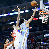 24 February 2016: Denver Nuggets guard Gary Harris (14) goes for the layup past Los Angeles Clippers forward Luc Richard Mbah a Moute (12) during the Denver Nuggets 87-81 victory over the Los Angeles Clippers, at the Staples Center, Los Angeles, California, USA.