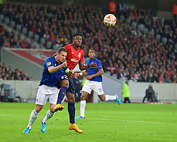 LILLE, FRANCE - Thursday, October 23, 2014: Lille OSC's Divock Origi in action against Everton's captain Phil Jagielka during the UEFA Europa League Group H match at Stade Pierre-Mauroy. (Pic by David Rawcliffe/Propaganda)