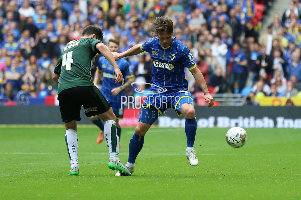 battle of the 4's Dannie Bulman midfielder of AFC Wimbledon (4) and Plymouth Argyle defender Carl McHugh (4) during the Sky Bet League 2 play off final match between AFC Wimbledon and Plymouth Argyle at Wembley Stadium, London, England on 30 May 2016. Photo by Stuart Butcher.