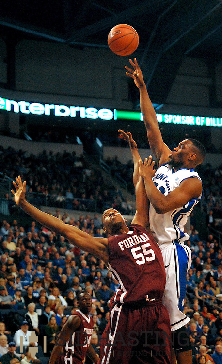 St. Louis  University basketball player Cory Remekum (32) launches a shot over Fordham University's Kervin Bristol (55) during the first half of the Billikens' 66-46 Atlantic 10 win over the Rams at Chaifetz Arena on the St. Louis University campus Saturday, Feb. 18, 2012 in St. Louis. Photo © copyright 2012 Sid Hastings.