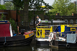© London News Pictures. 11/05/2015. A police officer stands next to a cordoned off area along the tow path of the canal at Little Venice in West London where a body has been found in a suitcase. The discovery was made on the Grand Union Canal near Delamere Terrace. Photo credit: Ben Cawthra/LNP