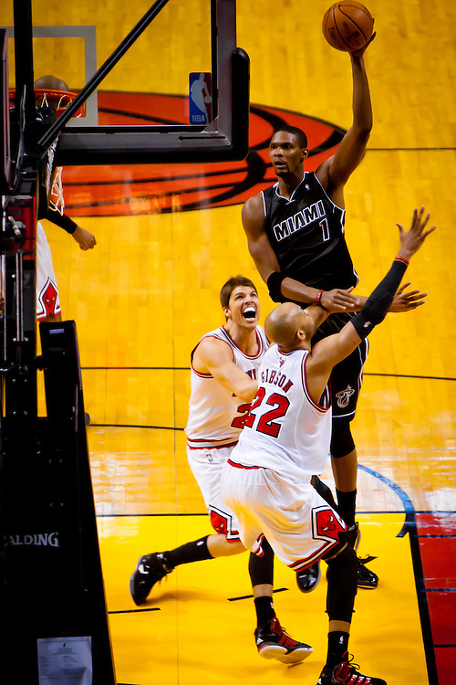 MIAMI, FL -- January 29, 2012 -- Miami's Chris Bosh shoots over  Chicago's Taj Gibson during the Heat's 97-93 win over the Bulls at American Airlines Arena in Miami, Fla., on Sunday, January 29, 2012.  (Chip Litherland for ESPN the Magazine)