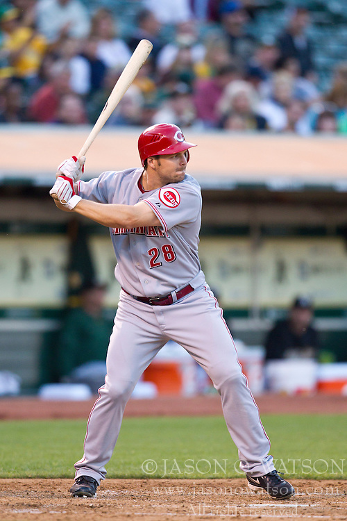 June 21, 2010; Oakland, CA, USA;  Cincinnati Reds left fielder Chris Heisey (28) at bat against the Oakland Athletics during the fourth inning at Oakland-Alameda County Coliseum.  Cincinnati defeated Oakland 6-4 in 10 innings.