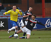 Greenock Morton's David O'Brien is tackled by Dundee's Kevin McBride - Dundee v Greenock Morton, William Hill Scottish Cup 5th Round at Dens Park .. - © David Young - www.davidyoungphoto.co.uk - email: davidyoungphoto@gmail.com