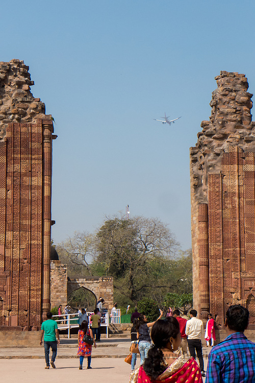 Tourists at UNESCO site; the Qutb complex.