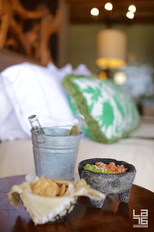 Capella Pedregal's bedside amenity: guacamole, salsa, tortilla chips and beer
