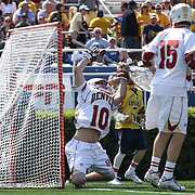 Denver Goalkeeper Ryan LaPlante (10) deflect the ball away from the goal in the second half of The NCAA Division I Men's Lacrosse Tournament game between the No. 5 seed Denver and No. 12 ranked Drexel Sunday, May. 18, 2014 at Delaware Stadium in Newark, DEL