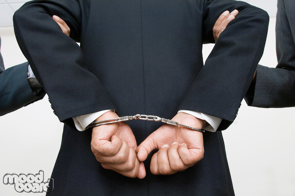 Businessman Being Arrested