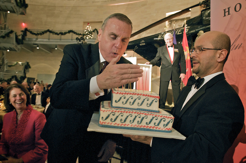 Retired U.S. Marine Corps General Jim Jones blows out candles during a surprise birthday in his honor at the Marine Corps Heritage Foundation Museum.  Photo by Johnny Bivera