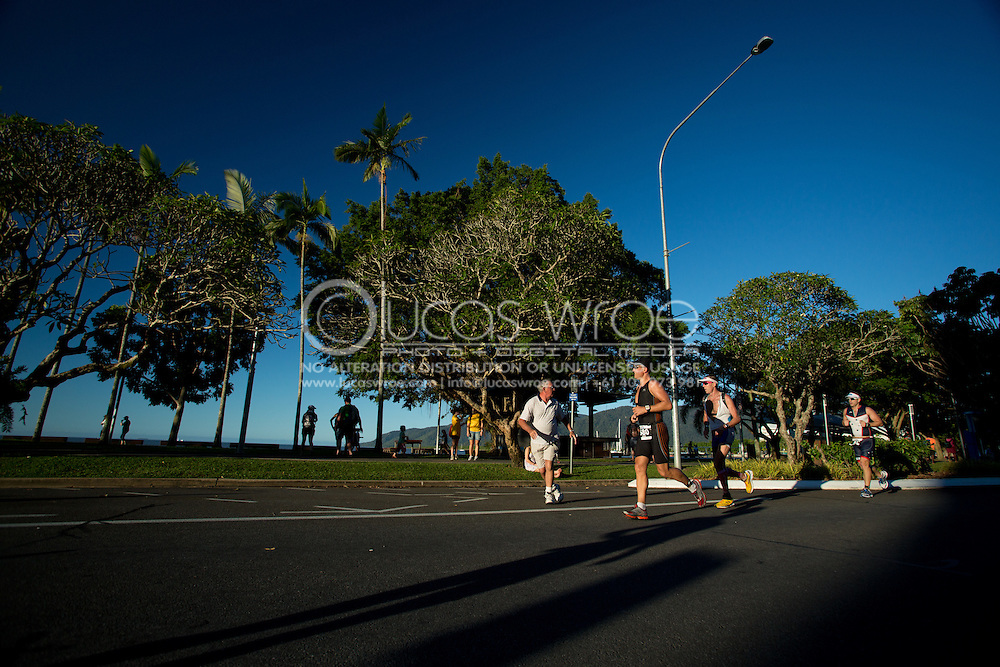 Ironman Age Group Competitors On The Runcourse As The Sun Sets On The 2012 Race. 2012 Ironman Cairns Triathlon. Cairns, Queensland, Australia. 03/06/2012. Photo By Lucas Wroe.