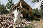 Mohammed Shah Hussain, a secondary school teacher at Nazarabad Government Boys School walks thought the remains of the school that was destroyed by Taliban militants ...The school was destroyed by the Taliban shortly after the singing of the peace accord on 18th February 2009 in  Nazarabad, SWAT.