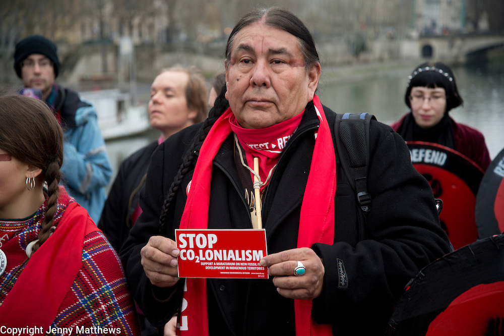 France, Paris December 2015 COP 21 UN Climate Conference. Indigenous people with a Red Line on the Pont des Arts