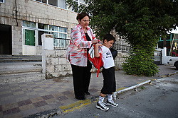 Mohammed Haitham Obeidi, 7, gets ready for his first day of school in Amman, Jordan, Aug. 20, 2007. His family fled Iraq after threats were made on his father's life. They are now awaiting asylum.