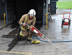 The Scottish Fire & Rescue Service unveiled it's latest weapon in firefighting, an ultra high pressure lance that allows firefighters to put out  fires more quickly using less water, and without having to enter the building. It is part of a £7.6 million GBP investment in 40 new smaller fire appliances that will enter service over the coming months, and will primarily be stationed in rural communities.<br /> <br /> © Dave Johnston/ EEm