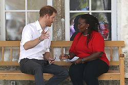Prince Harry and councillor Ministry of Health HIV Program Susette Neblett-Straughn talk during the 'Man Aware' event held by the Barbados National HIV/AIDS Commission in Bridgetown, Barbados, during his tour of the Caribbean.