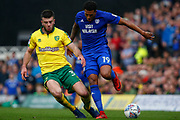 Norwich City defender Grant Hanley (31) makes a tackle on Cardiff City midfielder Nathaniel Mendez-Laing (19) during the EFL Sky Bet Championship match between Norwich City and Cardiff City at Carrow Road, Norwich, England on 14 April 2018. Picture by Phil Chaplin.