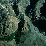 20 May 1976<br /> Proceed from Taliqan to Kishm. Grazing grasses on ridge top.<br /> Trees lining jui (irrigation canal). Dense green fields other side of river to right.