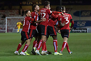 GOAL - John Akinde (29) is mobbed after scoring during the EFL Sky Bet League 1 match between Lincoln City and Tranmere Rovers at Sincil Bank, Lincoln, United Kingdom on 14 December 2019.