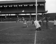 03/05/1970<br /> 05/03/1970<br /> 3 May 1970<br /> National Schools Hurling Final: Cork v Offaly at Croke Park, Dublin. <br /> S. O'Brien (Cork) sends the ball over the bar for a point despite close attention from Offaly defender, Nolan (3).