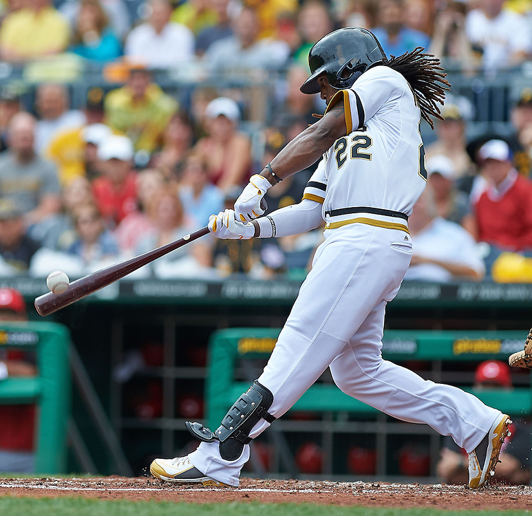 Pittsburgh Pirates Center Fielder Andrew McCutchen (#22) singles to left field in the sixth inning against the Cincinnati Reds at PNC Park in Pittsburgh on August 31, 2014. © 2014 Shelley Lipton.