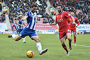 Wigan Athletic Forward, Will Grigg and currently Wigans leading Goal scorer unleashes a cross into the box during the Sky Bet League 1 match between Wigan Athletic and Oldham Athletic at the DW Stadium, Wigan, England on 13 February 2016. Photo by Mark Pollitt.