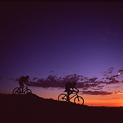 A picture of a couple and their dog mountain biking on Mount Lincoln above Truckee, CA.