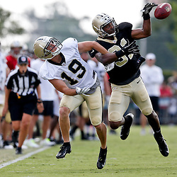 Aug 3, 2013; Metairie, LA, USA; New Orleans Saints cornerback Dion Turner (31) intercepts a pass to wide receiver Tim Toone (19) during a scrimmage at the team training facility. Mandatory Credit: Derick E. Hingle-USA TODAY Sports