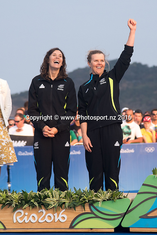 New Zealand's Jo Aleh and Polly Powrie celebrate winning Silver for the 470 class sailing race the 2016 Rio Olympics on Thursday the 18th of August 2016. © Copyright Photo by Marty Melville / www.Photosport.nzz