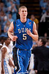 CHAPEL HILL, NC - MARCH 05: Mason Plumlee #5 of the Duke Blue Devils jogs off the court while playing the North Carolina Tar Heels on March 05, 2011 at the Dean E. Smith Center in Chapel Hill, North Carolina. North Carolina won 67-81. (Photo by Peyton Williams/UNC/Getty Images) *** Local Caption *** Mason Plumlee