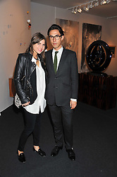 EDWARD TANG and CAROLYN HODLER at a 2nd private view of the Pavilion of Art & Design London 2011 held in Berkeley Square, London on 11th October 2011.