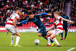 Tom Nichols of Bristol Rovers takes on Brad Halliday and Ben Whiteman of Doncaster Rovers - Mandatory by-line: Robbie Stephenson/JMP - 19/10/2019 - FOOTBALL - The Keepmoat Stadium - Doncaster, England - Doncaster Rovers v Bristol Rovers - Sky Bet League One