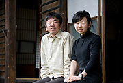 "Tomohiro Nozawa and Ai Saito (R) sit outside the 200-year-old building that once was a silk weaving school and is now the offices of the NPO for which they work, ""Egao Tsunagete"" in Hokuto City, Yamanashi Prefecture on 02  May 2012. Like many rural areas of Japan, Hokuto and surrounding districts are rapidly depopulating, though efforts by NPOs such as Egao and government initiatives are attempting to buck that trend..Photographer: Robert Gilhooly"