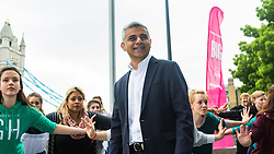 City Hall, London, May 19th 2016. PICTURED: Mayor of London Sadiq Khan poses with the dancers.<br /> <br /> The Mayor of London Sadiq Khan joins internationally-celebrated choreographer Akram Khan and Londoners from across the capital as they do their warm-ups at City Hall for the international Big Dance Pledge.<br />  <br /> The preview of the performance ahead of the world-wide Big Dance event. On Friday 20 May, over 40,000 people in 43 countries around the world will take part in the dance, which has been specially choreographed by Akram Khan.