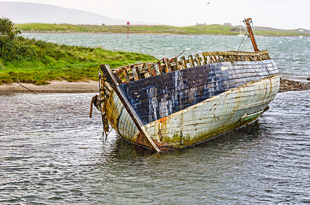 We were driving along the coast road in Co Sligo, Ireland when we spotted this shipwreck.  I don't know any more about this ship.  This treatment has been sharpened to give it a very realistic presentation