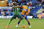Tom Elliott of AFC Wimbledon and Ryan Tafazolli during the Sky Bet League 2 match between Mansfield Town and AFC Wimbledon at the One Call Stadium, Mansfield, England on 5 September 2015. Photo by Stuart Butcher.